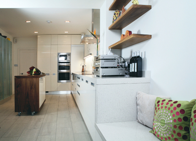 Wooden shelves with built in seating area of kitchen